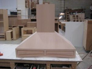 Custom wood vent hood from InE Cabinets