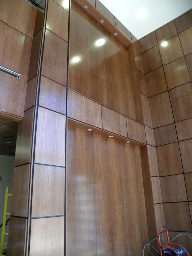 Walls next to Elevators.
