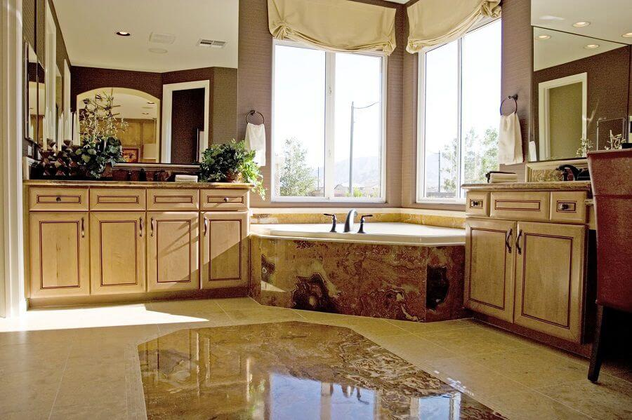 luxury bathroom with granite countertops bath and floor
