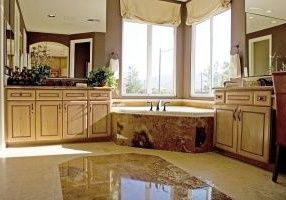 luxury bathroom with granite countertops bath and floor
